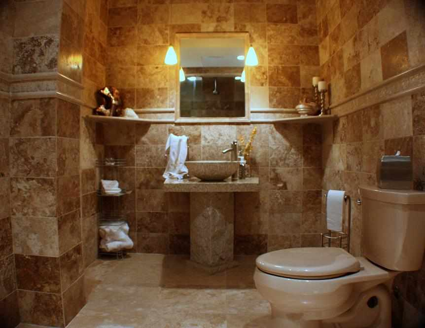 Travertine Bathroom with Pedestal Sink - JWConstructionandDesign.com | Chicago area bathroom remodel